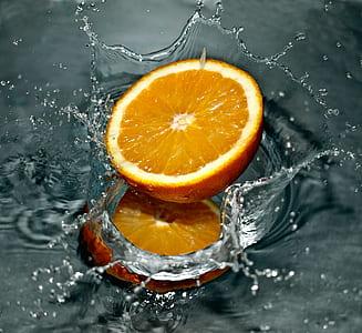 sliced orange with dew