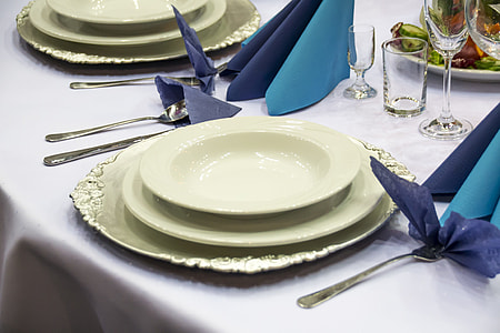three white ceramic plates on table