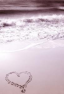 heart sand decor near ocean