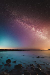 starry skies over water shoal