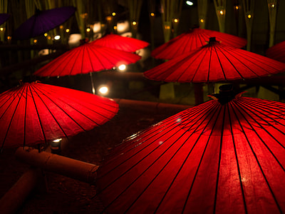 six red japanese umbrellas at nighttime
