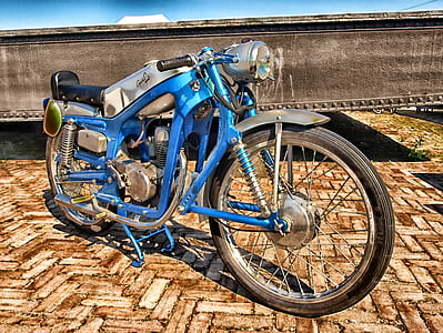 high-saturated photography of customized classic blue motorcycle