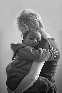 boy hugging woman