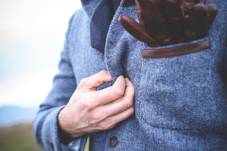 Fastening Button on a Coat