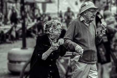 photo of man and woman holding ice creams