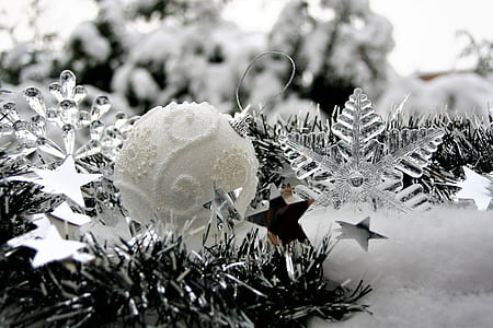 greyscale photo of Christmas bauble and clear snowflake decors