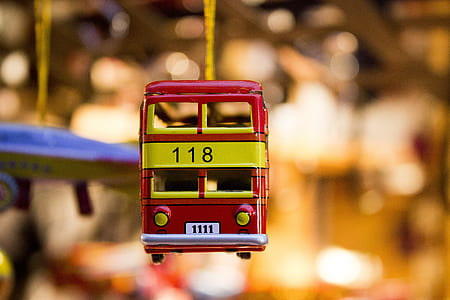 red and yellow die-cast Double Decker Bus Christmas ornament hanging