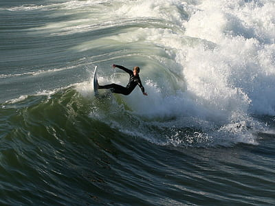 man ride on surfboard