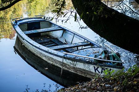 docked white canoe