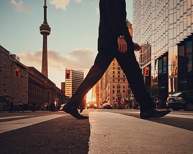 person walking on concrete road