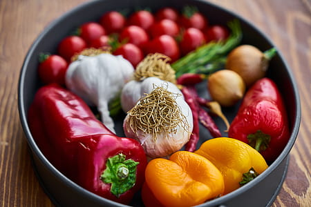 assorted-color vegetables in round black pan