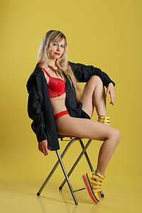 woman wearing red lingerie and black jacket