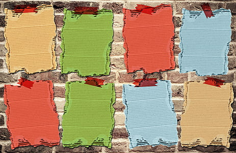 illustration of assorted-color cardboards on wall