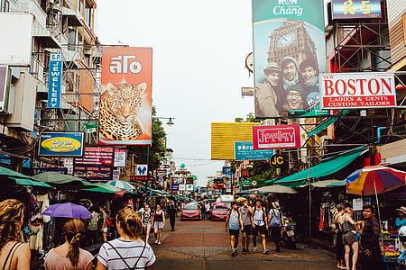 people walking on street market