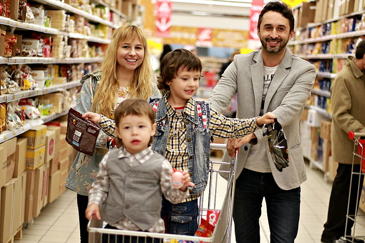 man, woman, and children's doing groceries