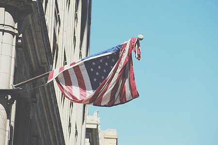 U.S.A flag hanged at the buildings corner area