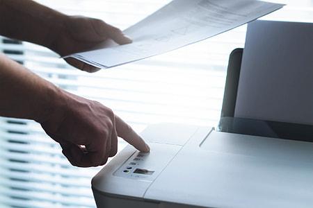 Man using office printer