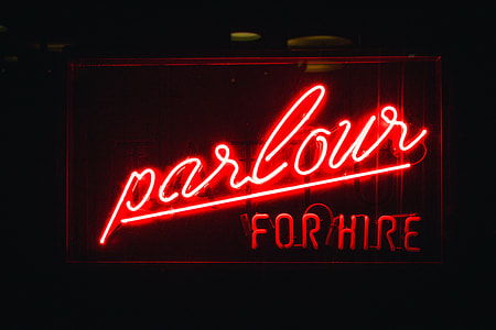 lighted red parlour for hire neon signage
