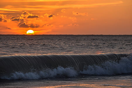 water waves during sunset