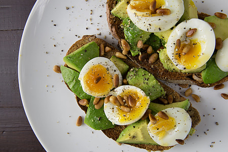 Soft-boiled eggs and avocado on toasted walnut bread