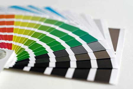 paint color fan deck on white surface