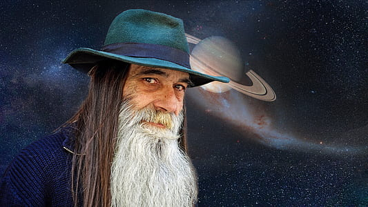 man in blue hat with planet background