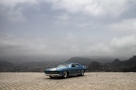 photography of blue Ford Mustang Mach 1