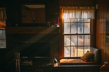 fireplace near brown pillow