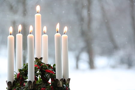 white candle on snow