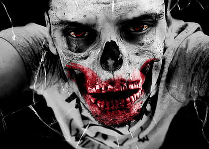 selective color photography of man with bloody skeleton face art