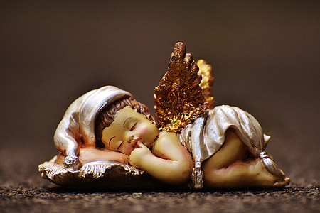 baby sleeping ceramic party favor