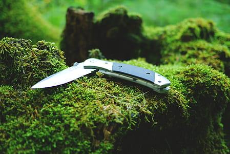 black and grey pocketknife
