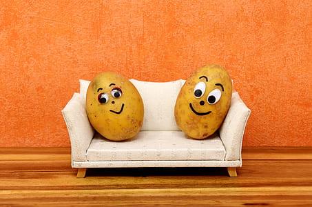 couple potatoes on white sofa illustration