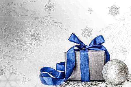 gray gift box with blue ribbon artwork
