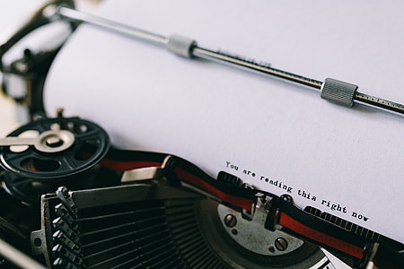 Closeup view of typing quotes on the old typewriter