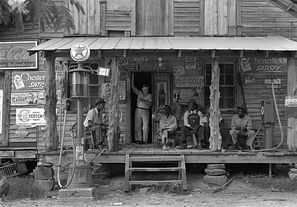 grayscale photo of people sitting outside the hub