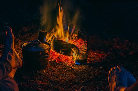 stainless steel pot near bonfire