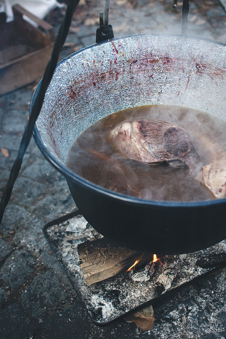 Cooking in a kettle outside