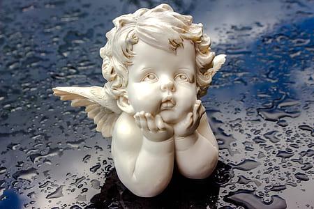 white ceramic angel head bust