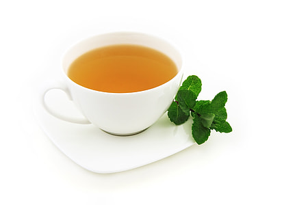 teacup with tea and saucer