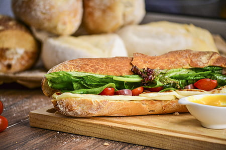 bread with sliced vegetables and sauce