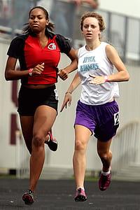photo of two women running on street