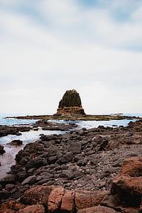 rocks beside sea