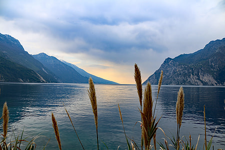 photo of blue body of water and mountain at daytime
