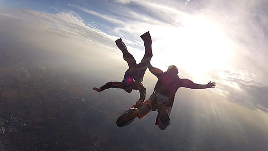 two person sky diving during daytime