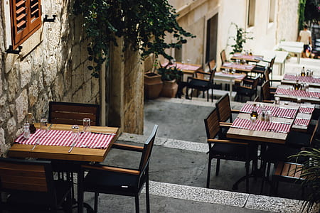 brown wooden tables along the street during daytime