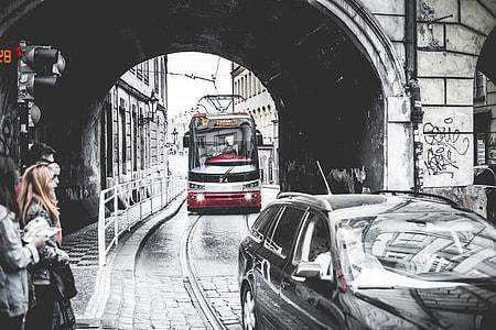 Tram Going Through The Tunnel Under The Bridge