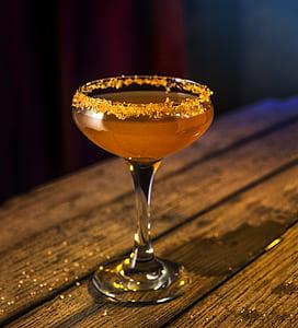 Clear Liquor Glass With Orange Liquid