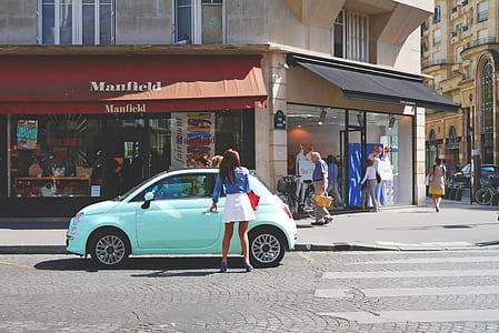 woman wearing white midi skirt