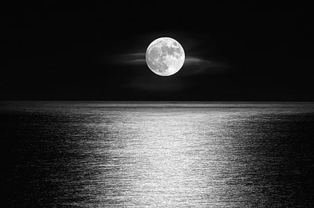 body of water under full moon during nighttime